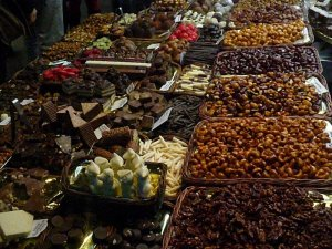 Dried fruits and spiced nuts on display at a market in Barcelona.